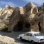 Fred Flintstone's house in Bedrock? An old car in front of a 1,000 year old rock house in Goreme Open-Air Museum, Cappadocia, Turkey