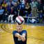 Parachute Rigger 3rd Class Michael Johnston bump-passes the ball during a sitting volleyball game.