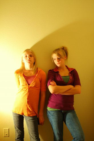 Two Moody Annoyed Girls in Colorful Clothes