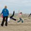 Kids play skiprope on Morro Strand State Beach - Wholesome Family Scene