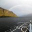 Rainbow forms behind USS Boone