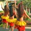 Three lovely hula dancers from behind