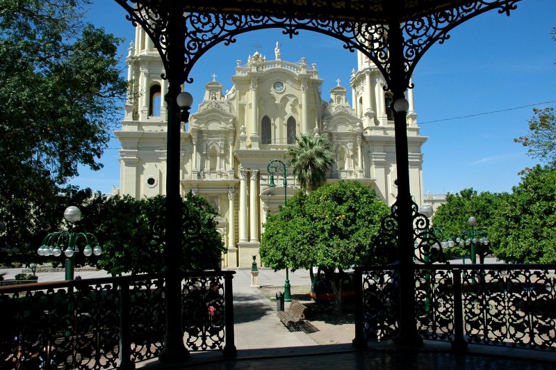 Catholic Church through the detail of the Iron Gazebo, Town Square, Hermosilla, Jalisco, Mexico