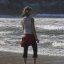 Pretty young girl wading in the water in Morro Bay, CA