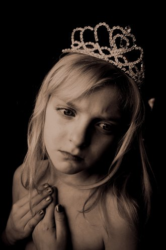 Girl With Sad Eyes Wearing A Crown