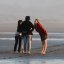 Four young female girls conversing and cavorting on the Morro Strand State Beach