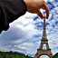 holding the eiffel tower