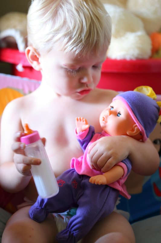 Little Daddy Caring for Baby Doll