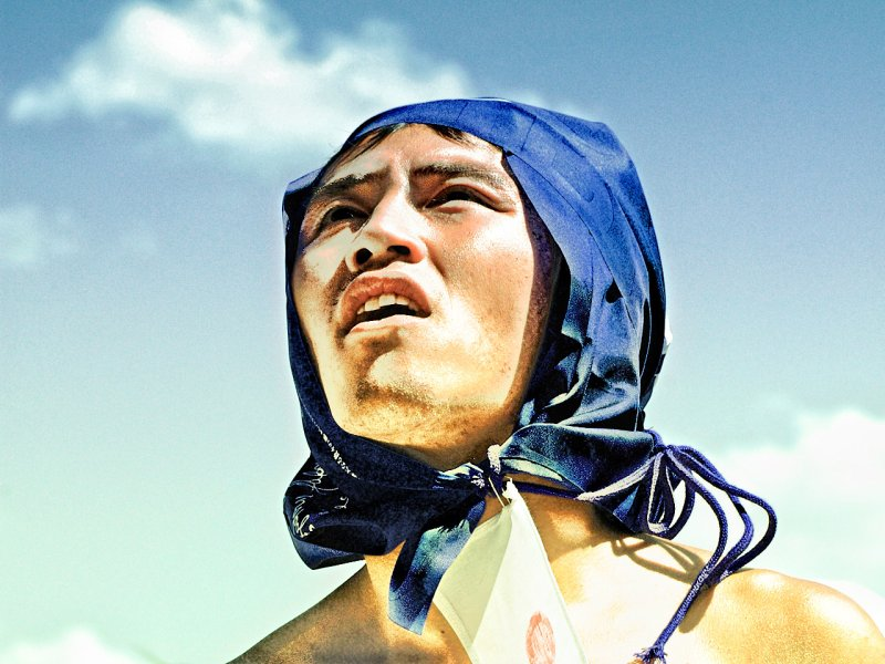 Japanese guy looking up to the sky