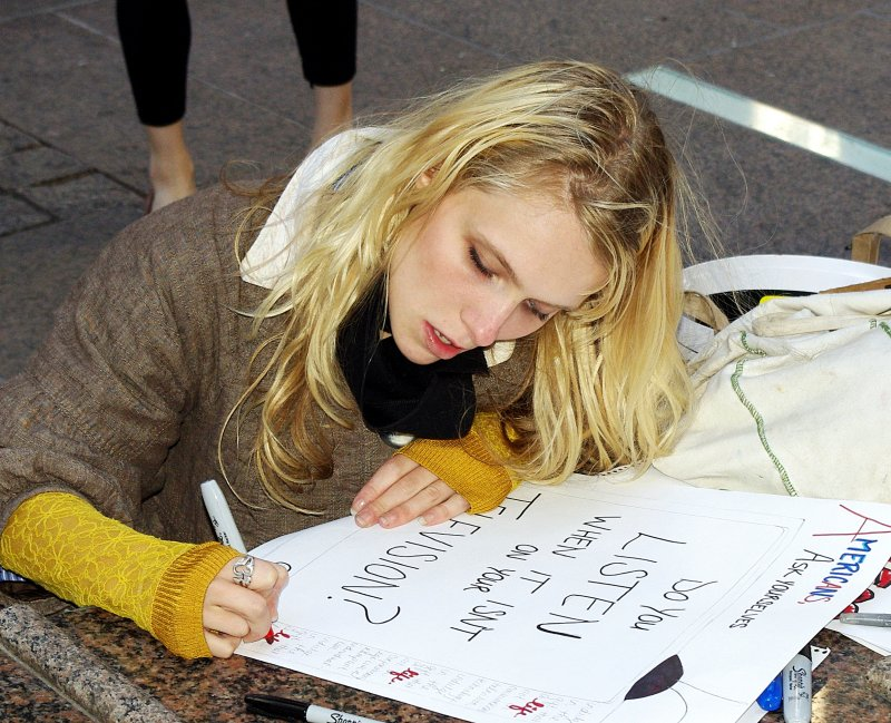 Day 2 Occupy WS Girl Sign 2011 Shankbone