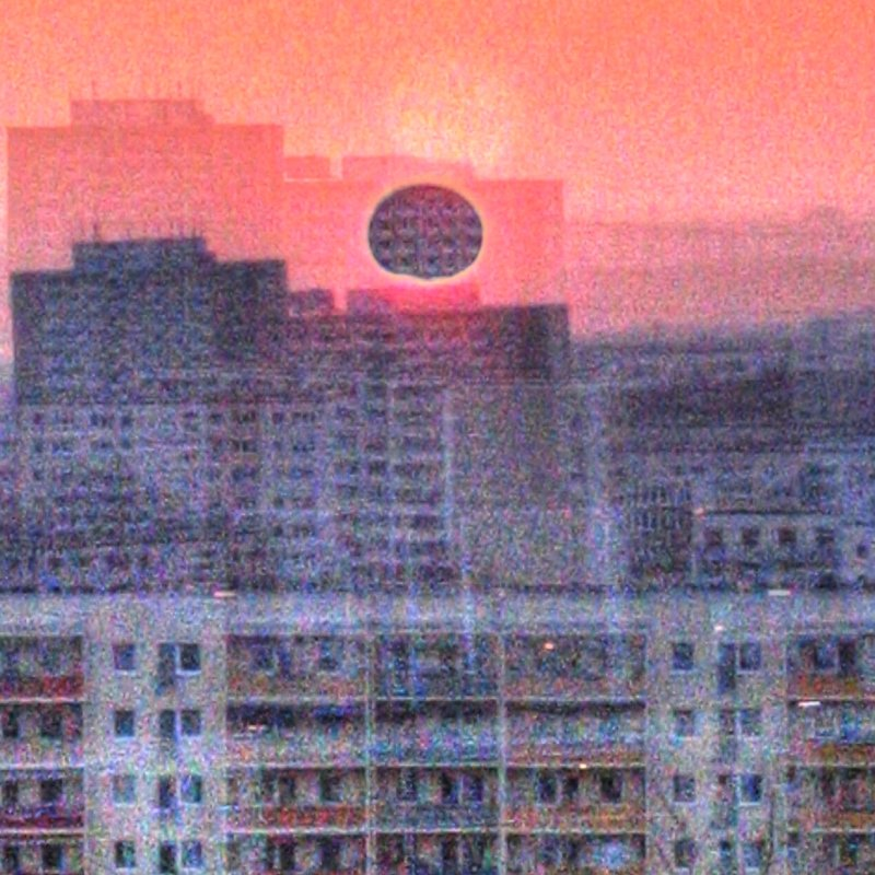 black square sun hypeЯReally eclipsed through layers of social housing blocks