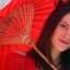Gorgeous brunette with a red umbrella