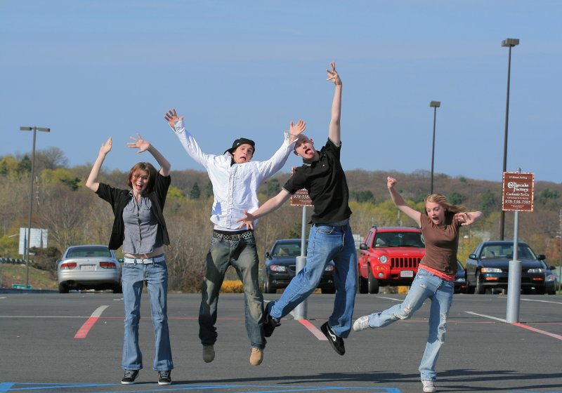 Free Four Teens Jumping in Parking Lot Creative Commons