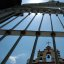 """""""This sky where we live is no place to lose your wings so love, love, love."""" Freedom of the bird, over the Church bell tower and gate, Zona Centro, Guadalajara, Jalisco, Mexico"""