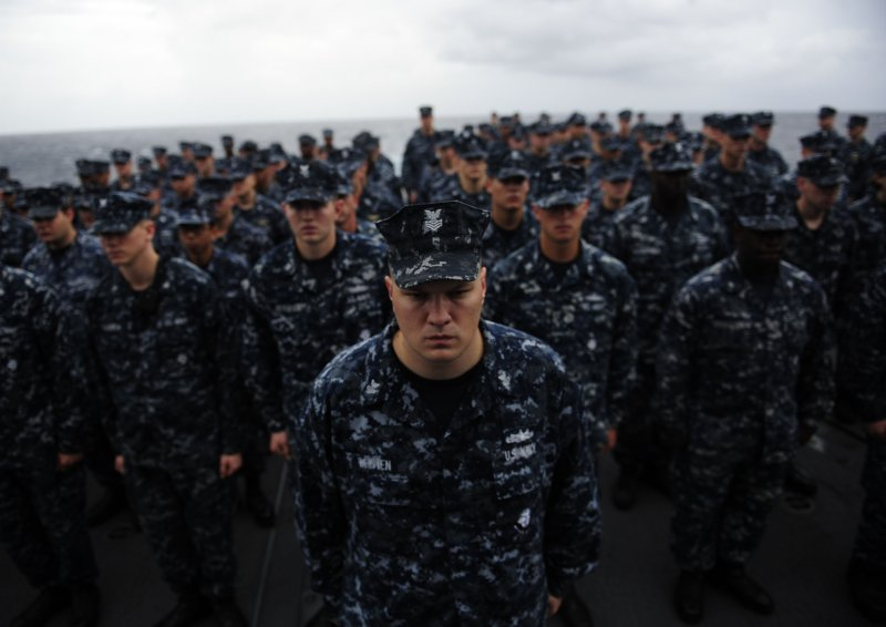 Sailors stand in formation during a 9/11 Remembrance ceremony rehearsal aboard USS Mobile Bay