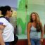 Friends meet and chat, using a cell phone to say hi, Puerto Vallarta, Jalisco, Mexico