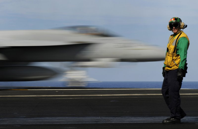 A Sailor supervises the launching of aircraft on USS Carl Vinson (CVN 70).