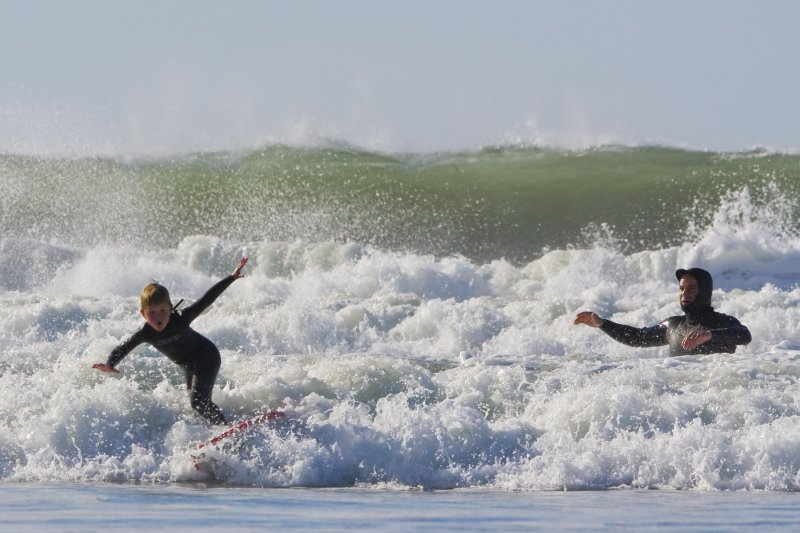 Father and son surf lesson in Morro Bay, CA 9 of 12