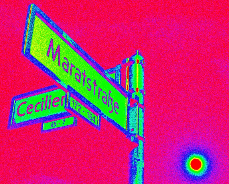 chartreuse street-placque named for the french revolutionary Jean-Paul Marat crosses out the prussian monarchist Cecilien while the moon of red Mahagon is tinging the sky pinkly