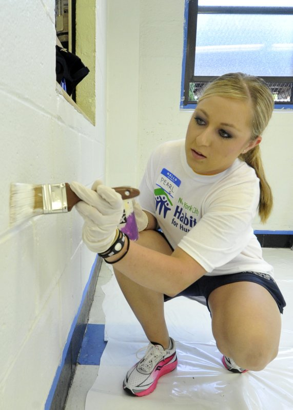 USS New York Sailor takes part in a Habitat for Humanity Brushes with Kindness community service project