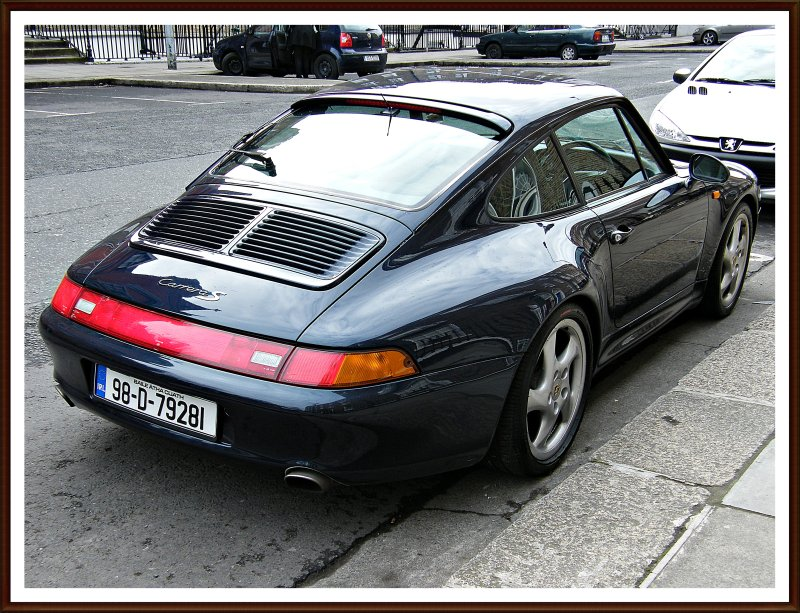 Wonderful and rare Porsche Carrera S Coupe in black - a must favorite for car aficinados around the world - boy racer/girl chaser - your choice!:) Dublin 2010 and more...:)