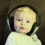 Baby Wearing Large Headphones Listening To Music
