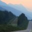 Heading into a smoke filled sunrise near Jasper from Mt. Robson with the road to myself!