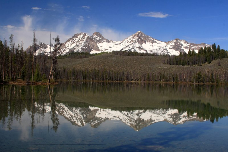 Mountains in the Sawtooth Range reflected on Little Redfish Lake near Stanley, Idaho
