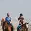 Two Female Horse riders on Morro Strand State Beach