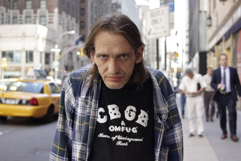 Man with CBGB & OMFUG shirt