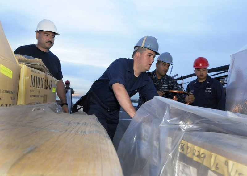 USS Blue Ridge Sailors load supplies for possible earthquake/tsunami relief assistance to Japan.