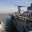 Sailors and Marines man the rails as USS Iwo Jima arrives in New York