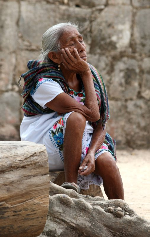 Sweet but ancient Mayan vendor looking totally frazzled at Chichen Itza
