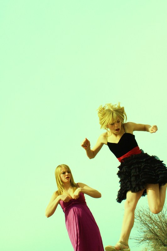 Two Funny Girls Ruffled Dress Jumping