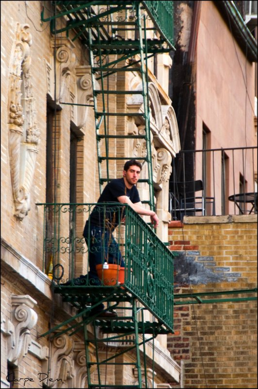 Man on a Fire Escape, East Village NYC