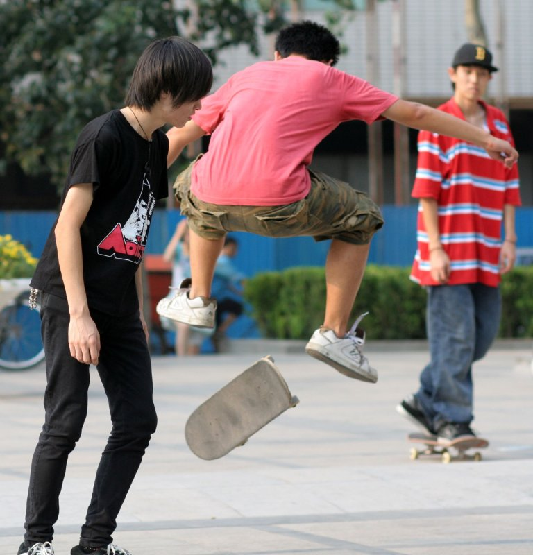 skateboarders in front of church