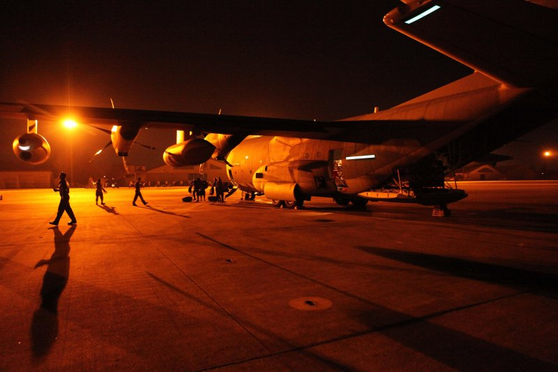 Sailors and Marines disembark aircraft to support Japan relief efforts.