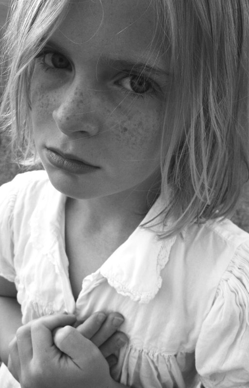 Freckle Face Girl With Sad Eyes