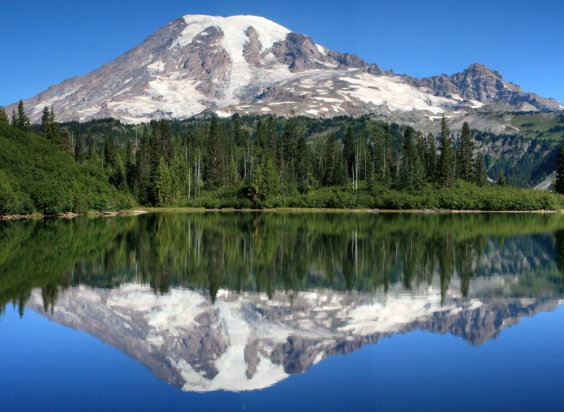 Stitched shot of Mt. Rainier and Little Tahoma reflected on Bench Lake