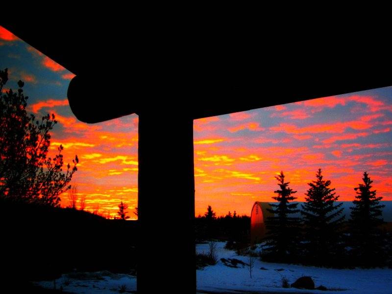 This morning's sunrise from my front door.