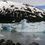 Stitched shot of icebergs on Portage Lake, Alaska, with Bard Peak in the distance