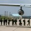 Marines board aircraft enroute to Japan to assist in relief efforts.