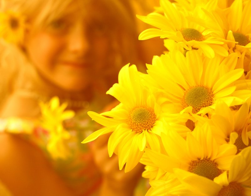 Little Girl Smiling With Yellow Flowers