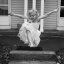 Little Girl Jumping in Party Dress