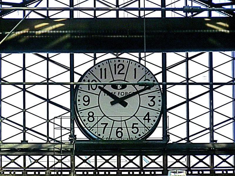 Back side of the front entrance clock of the Principe Pío Station in Madrid Spain