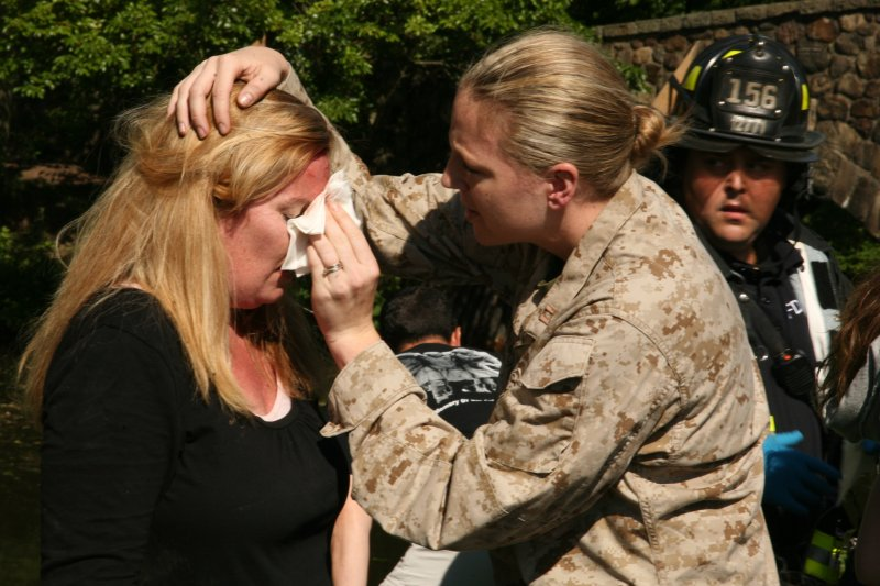Marine provides first aid at NYC Fleet Week helicopter raid