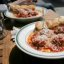 chicken meatballs with tomato sauce and polenta, from meatball shop