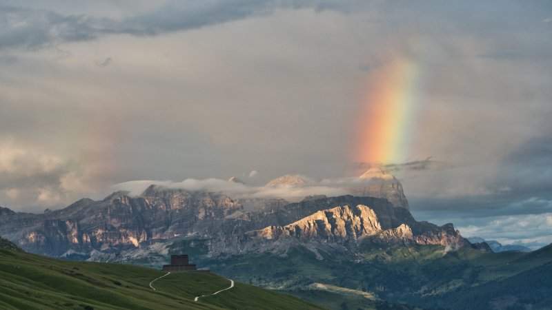 Rainbow and sunset in Dolomites