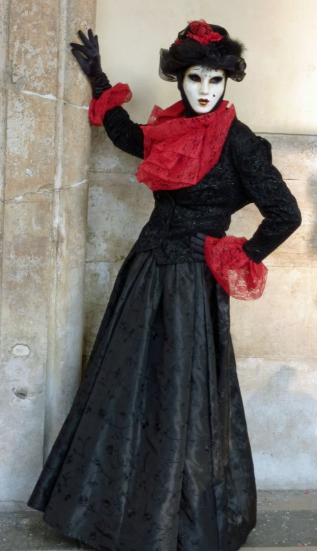 Lovely lass in black with a red scarf and white mask (P1010134a)